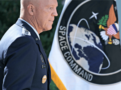"WASHINGTON, DC - AUGUST 29: U.S. Air Force Space Command Gen. John ""Jay"" Raymond stands next to the flag of the newly established U.S. Space Command, the sixth national armed service, in the Rose Garden at the White House August 29, 2019 in Washington, DC. Citing potential threats from China …"
