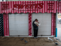 GREAT YARMOUTH, ENGLAND, - FEBRUARY 07: Birds look on as a man eats a bag of chips outside a closed sweet shop in Great Yarmouth Market on February 7, 2017 in Great Yarmouth, United Kingdom. The town of Great Yarmouth on the East Coast of England voted by 72% to …