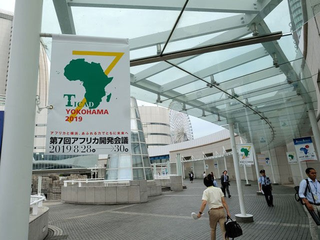 Banners of the Tokyo International Conference on African Development (TICAD) are displayed on a street near the conference hall in Yokohama on August 27, 2019. - Japan hosts development talks with African leaders this week, looking to boost its presence on the continent and offer an alternative to investments by …