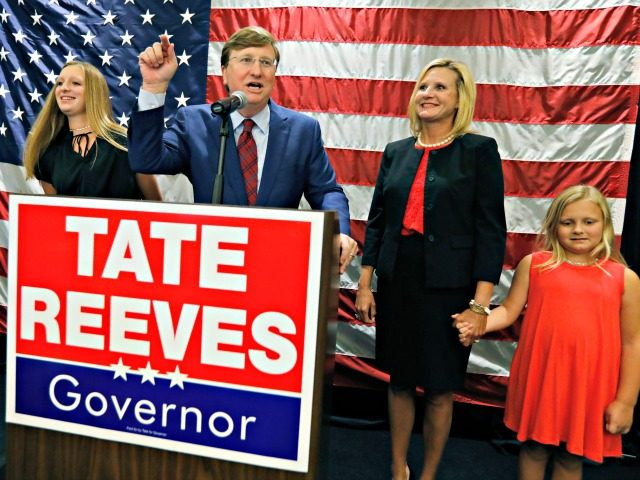 Lt. Gov. Tate Reeves, center, flanked by daughter Tyler Reeves, left, wife Elee Reeves, second from right, and his youngest daughter, Maddie Reeves, speaks to supporters at his victory party after being declared winner of the runoff for the Republican nomination for governor in Jackson, Miss., Tuesday, Aug. 27, 2019. …
