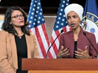 FILE - In this July 15, 2019, file photo, U.S. Rep. Ilhan Omar, D-Minn, right, speaks, as U.S. Rep. Rashida Tlaib, D-Mich. listens, during a news conference at the Capitol in Washington. The U.S. envoy to Israel said he supports Israel's decision to deny entry to two Muslim congresswomen ahead …