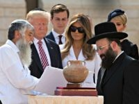 US President Donald Trump (2nd L), senior advisor Jared Kushner (3rd L), first lady Melania Trump (C) and Ivanka Trump, the president's daughter, listens to Rabbi Shmuel Rabinovitch (R) during a visit to the Western Wall, the holiest site where Jews can pray, in Jerusalems Old City on May 22, …