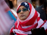 WASHINGTON, DC - OCTOBER 18: A woman wears an American flag themed hijab as she attends a protest against the Trump administration's proposed travel ban, October 18, 2017 in Washington, DC. Early Wednesday morning, a federal judge in Maryland granted a motion for a preliminary injunction on the administration's travel …