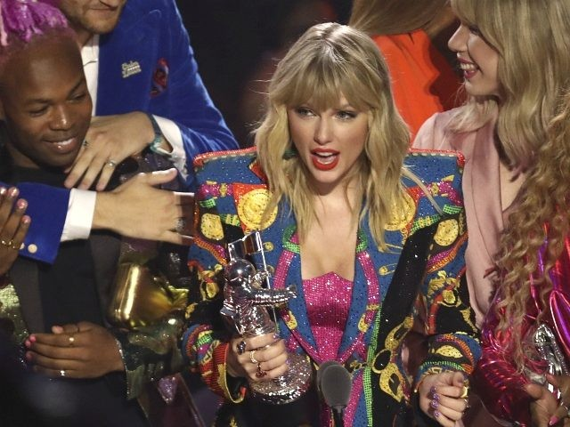 """Taylor Swift accepts the video of the year award for """"You Need to Calm Down"""" at the MTV Video Music Awards at the Prudential Center on Monday, Aug. 26, 2019, in Newark, N.J. (Photo by Matt Sayles/Invision/AP)"""