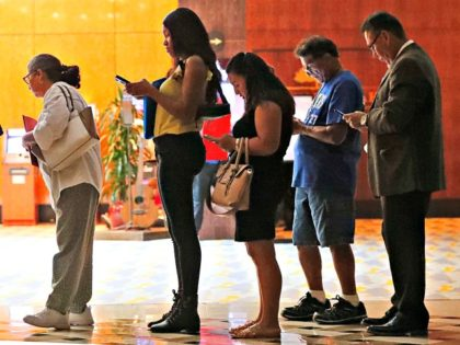 Job applicants wait in line at the Seminole Hard Rock Hotel & Casino Hollywood during a job fair in Hollywood, Fla., on Thursday. Wilfredo Lee/AP