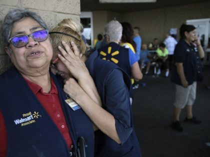 Distraught Walmart employees outside the scene of a shooting that left 20 dead and 26 injured. (Mark Lambie/The El Paso Times via AP)