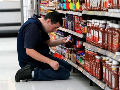 In this Nov. 9, 2018, file photo a Walmart associate stocks a shelf at a Walmart Supercenter in Houston. On Monday, Jan. 7, 2019, the Institute for Supply Management, a trade group of purchasing managers, issues its index of non-manufacturing activity for December. (AP Photo/David J. Phillip)