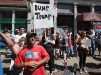 DAYTON, OHIO - AUGUST 07: Pro and anti-Trump demonstrators protest in the Oregon District, where a mass shooting early Sunday morning left nine dead and 27 wounded, on August 07, 2019 in Dayton, Ohio. President Donald Trump visited the city today to offer his support to the community but did …