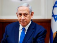 "Israeli Prime Minister Benjamin Netanyahu attends the weekly cabinet meeting in Jerusalem on July 14, 2019. - Netanyahu today warned the head of Lebanon's Tehran-backed Hezbollah that ""crushing"" retaliation would follow any attack after its leader said the group's rockets could reach Tel Aviv. (Photo by RONEN ZVULUN / POOL …"