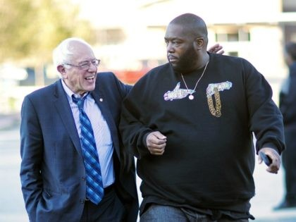 Democratic presidential candidate Sen. Bernie Sanders, I-Vt. left, walks in with rapper Killer Mike for a visit to The Busy Bee Cafe Monday, Nov. 23, 2015, in Atlanta. (AP Photo/David Goldman)