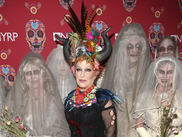 """Bette Midler attends Bette Midler's annual """"Hulaween"""" party, to benefit The New York Restoration Project, at The Waldorf-Astoria Hotel on Friday, Oct. 30, 2015, in New York. (Photo by Andy Kropa/Invision/AP)"""