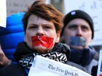 People take part in a protest outside the New York Times on February 26, 2017 in New York. The White House denied access Frebuary 24. 2017 to an off-camera briefing to several major US media outlets, including CNN and The New York Times. Smaller outlets that have provided favorable coverage …