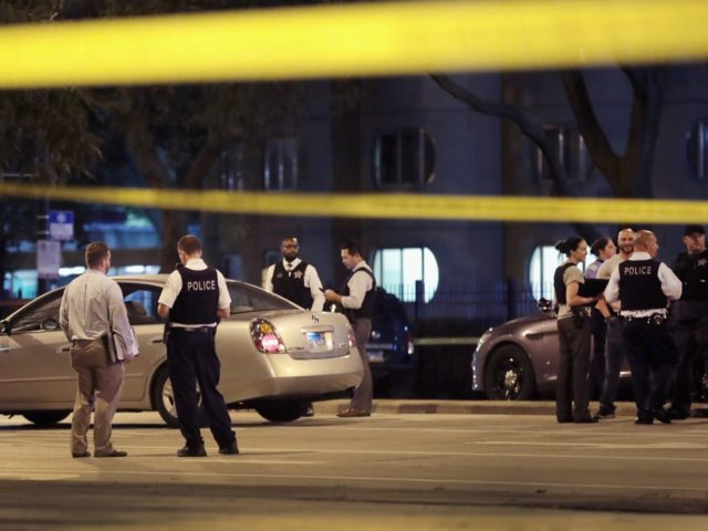 CHICAGO, IL - SEPTEMBER 19: Police investigate the scene of a shooting near the Chinatown neighborhood where four people were shot in an apparent road rage incident on September 19, 2018 in Chicago, Illinois. A 6-month-old infant boy and a thirteen-year-old girl were among the victims. (Photo by Scott Olson/Getty …