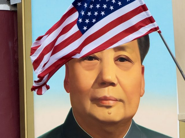 A US flag is displayed in front of the portrait of China's late communist leader Mao Zedong outside the Forbidden City in Beijing on November 8, 2017. US President Donald Trump toured the Forbidden City with Chinese leader Xi Jinping on November 8 as he began the crucial leg of …