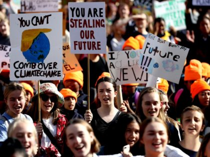 AUCKLAND, NEW ZEALAND - MAY 24: School children march down Queen Street during a climate change protest on May 24, 2019 in Auckland, New Zealand. Thousands of students across New Zealand are demonstrating in the streets again to fight for climate change action. (Photo by Hannah Peters/Getty Images)