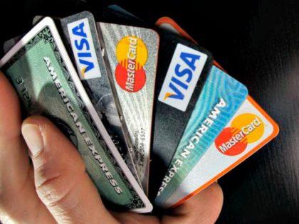 credit cards. AP PhotoElise Amendola
