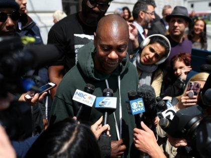 """SAN FRANCISCO, CALIFORNIA - MAY 21: Comedian Dave Chappelle speaks to members of the media during a rally to try and save the famed Punchline Comedy Club on May 21, 2019 in San Francisco, California. Dave Chappelle and CNN's """"United Shades of America"""" host W. Kamau Bell were joined by …"""
