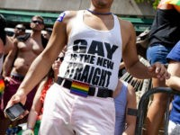 "NEW YORK - JUNE 24: A man wears a shirt that reads ""gay is the new straight"" during the New York City Gay Pride March on June 24, 2012 in New York City. The annual civil rights demonstration commemorates the Stonewall riots of 1969, which erupted after a police raid …"