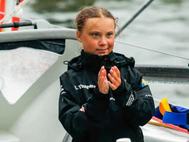 "Swedish climate activist Greta Thunberg, 16, and father Svante Thunberg arrive in the US after a 15-day journey crossing the Atlantic in the Malizia II, a zero-carbon yacht, on August 28, 2019 in New York. - ""Land!! The lights of Long Island and New York City ahead,"" she tweeted early …"