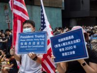 "Protesters hold signs as they gather in Mong Kok during a general strike in Hong Kong on August 5, 2019, as simultaneous rallies were held across seven districts. - Hong Kong's pro-democracy protesters are close to creating a ""very dangerous situation"", the city's leader warned on August 5 as train …"