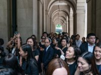 Lawyers and legal professionals gather outside the Court of Final Appeal ahead of a silent march during a protest on August 7, 2019 in Hong Kong, China. Pro-democracy protesters have continued rallies on the streets of Hong Kong against a controversial extradition bill since 9 June as the city plunged …