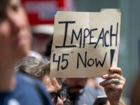 "NEW YORK, NY - JUNE 15: A protestor holds a sign calling for the impeachment of U.S. President Donald Trump during a demonstration on June 15, 2019 in New York City. Major cities across the country are expected to hold ""#ImpeachTrump Day of Action"" protests on Saturday to demand that …"