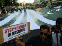 TOPSHOT - Demonstrators hold a giant flag of Pakistan-administered Kashmir during an anti-Indian protest in Karachi on August 18, 2019. - Tensions have soared since India earlier this month stripped the part of Kashmir that it controls of its autonomy, sparking calls from Pakistan for the international community to intervene …