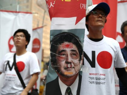 """SEOUL, SOUTH KOREA - AUGUST 03: South Korean protesters participate in a rally to denounce Japan's new trade restrictions on South Korea in front of the Japanese embassy on August 03, 2019 in Seoul, South Korea. Japan approved a bill removing South Korea from its """"whitelist"""" of trusted trade partners. …"""
