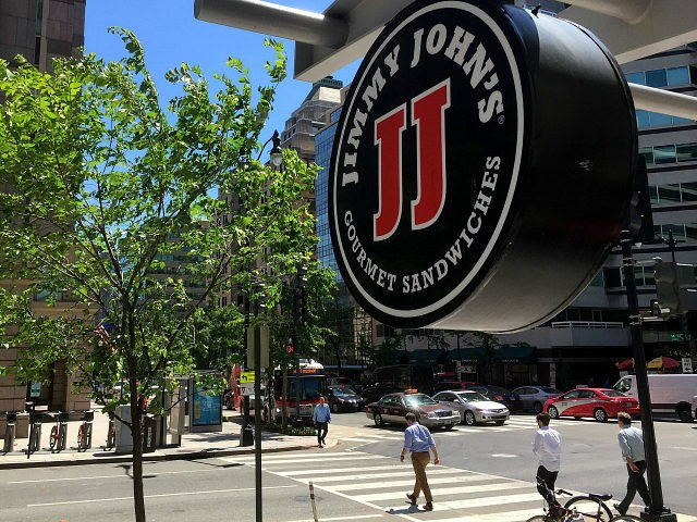 A logo of the sandwich restaurant chain, specializing in delivery Jimmy John's hangs outside one of their shops in downtown Washington, DC, June 9, 2016 A US sandwich chain is being sued for locking its low-paid workers into non-compete agreements more typical of high-tech workers or top executives. The state …