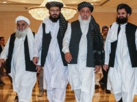 Mohammad Nabi Omari (C-L), a Taliban member formerly held by the US at Guantanamo Bay and reportedly released in 2014 in a prisoner exchange, Taliban negotiator Abbas Stanikzai (C-R), and former Taliban intelligence deputy Mawlawi Abdul Haq Wasiq (R) walk with another Taliban member during the second day of the …