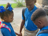 Jamisha Harris shared a photo of her children Eugene Jacobs, 10, Jorden Jacobs, 8, and Emily Jacobs, 7, praying before their first day of school. (Courtesy of Jamisha Harris)