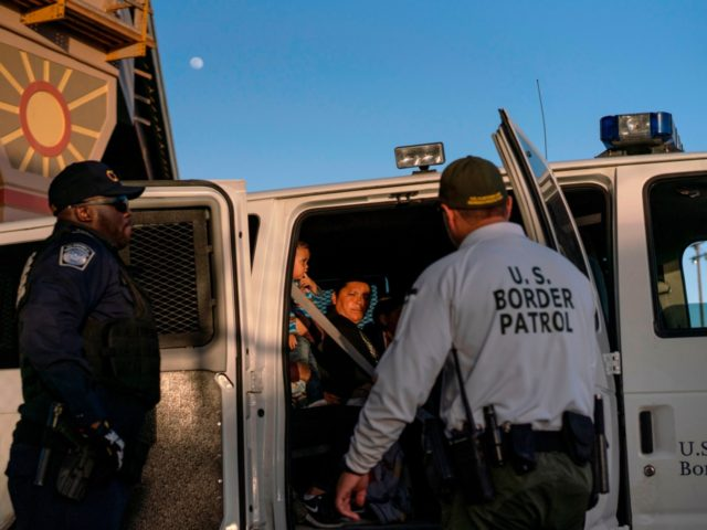 Migrants, mostly from Central America, board a van which will take them to a processing center, on May 16, 2019, in El Paso, Texas. - About 1,100 migrants from Central America and other countries are crossing into the El Paso border sector each day. US Customs and Border Protection Public …