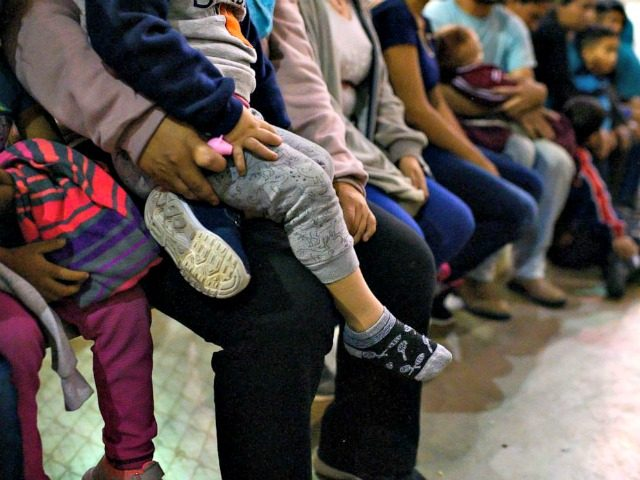 Carolyn Van Houten/The Washington Post via Getty Images Recently detained migrants, many of them family units, sit and await processing in the US Border Patrol Central Processing Center in McAllen, Texas on August 12, 2019.