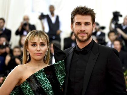 """Miley Cyrus, left, and Liam Hemsworth attend The Metropolitan Museum of Art's Costume Institute benefit gala celebrating the opening of the """"Camp: Notes on Fashion"""" exhibition on Monday, May 6, 2019, in New York. (Photo by Charles Sykes/Invision/AP)"""