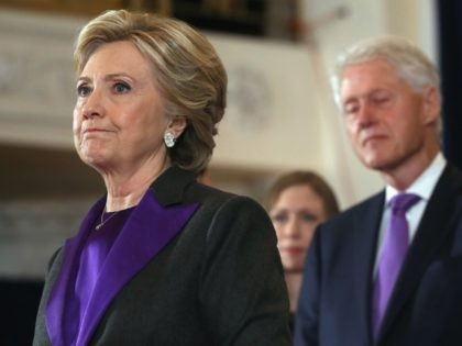 NEW YORK, NY - NOVEMBER 09: Former Secretary of State Hillary Clinton, accompanied by her husband former President Bill Clinton, pauses as she concedes the presidential election at the New Yorker Hotel on November 9, 2016 in New York City. Republican candidate Donald Trump won the 2016 presidential election in …