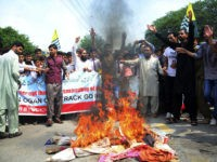 Pakistani Kashmiris burn effigies of Indian leaders at a protest in Muzaffarabad, Pakistan, capital of Pakistani Kashmir, Friday, Aug. 9, 2019. Islamabad said it would downgrade its diplomatic ties with New Delhi, expel the Indian ambassador and suspend trade. Prime Minister Imran Khan told Pakistan's National Security Committee that his …