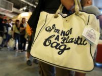 "NEW YORK - JULY 18: Customers stand in line after purchasing the ""I'm Not a Plastic Bag"" shopping totes by Anya Hindmarch at a Whole Foods Market July 18, 2007 in New York City. 20,000 of the environmentally-friendly bags went on sale for $15 each at 8:00 a.m. this morning. …"