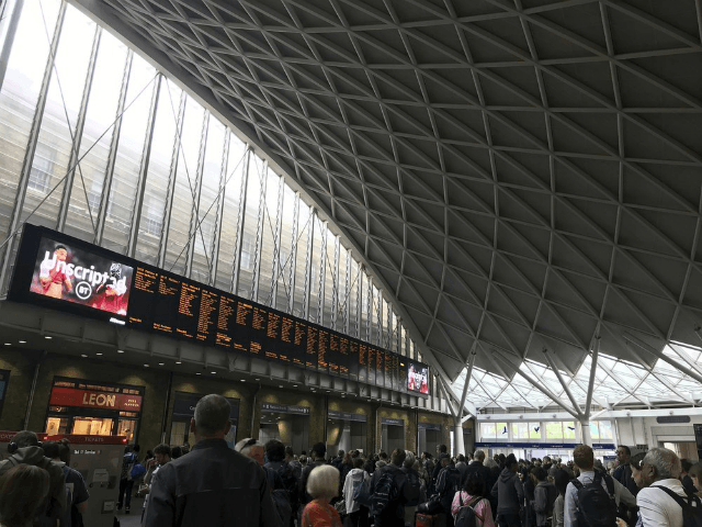 People wait for trains at King's Cross station in London Saturday, Aug. 10, 2019 a day after all services in and out of the station were suspended when a power cut caused major disruption across the country. Operators of Britain's electricity network say a power cut that affected a million …