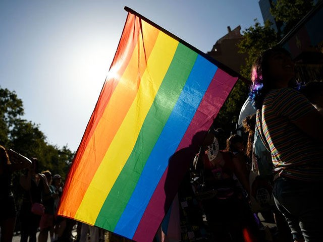 Participants wave a rainbow flag during the 2019 Gay Pride parade in Barcelona on June 29, 2019. (Photo by Josep LAGO / AFP) (Photo credit should read JOSEP LAGO/AFP/Getty Images)