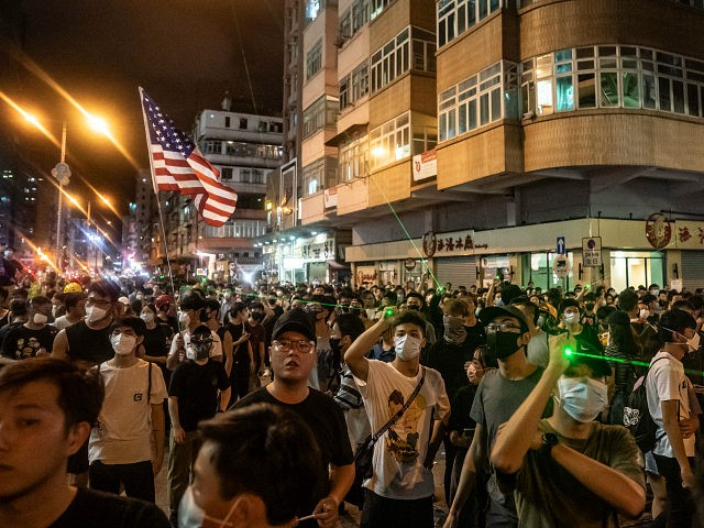 HONG KONG, CHINA - AUGUST 14: Protesters take part in a demonstration on Hungry Ghost Festival day in Sham Shui Po district on August 14, 2019 in Hong Kong, China. Pro-democracy protesters have continued rallies on the streets of Hong Kong against a controversial extradition bill since 9 June as …