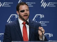 LAS VEGAS, NEVADA - APRIL 06: U.S. Rep. Dan Crenshaw (R-TX) speaks at the Republican Jewish Coalition's annual leadership meeting at The Venetian Las Vegas after appearances by U.S. President Donald Trump and Vice President Mike Pence on April 6, 2019 in Las Vegas, Nevada. Trump has cited his moving …