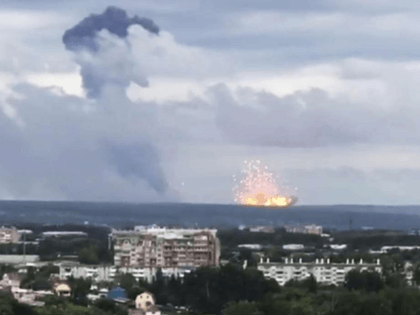 In this image taken from video, explosions are seen at the military base, about 10 kilometers from Achinsk, Krasnoyarsk region, Russia Far East, Monday, Aug. 5, 2019. An explosion at a Russian military base in Siberia has set off fires and injured at several people. (Liza Uskova via AP)
