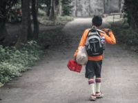 young boy walking