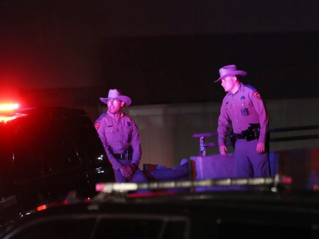 EL PASO, TEXAS - AUGUST 03: Police keep watch outside Walmart near the scene of a mass shooting which left at least 20 people dead on August 3, 2019 in El Paso, Texas. A 21-year-old male suspect was taken into custody in the city which sits along the U.S.-Mexico border. …