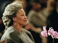 FILE - In this April 5, 1994 file photo, Toni Morrison as she holds an orchid at the Cathedral of St. John the Divine in New York. The Nobel Prize-winning author has died. Publisher Alfred A. Knopf says Morrison died Monday, Aug. 5, 2019 at Montefiore Medical Center in New …