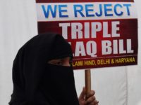 "An Indian Muslim woman holds a placard during a protest against the ""triple talaq bill"" in New Delhi on April 4, 2018. Muslim women in India have gathered to protest the ""Muslim Women (Protection of Rights on Marriage) Bill 2017"" that makes triple talaq illegal. Instant divorce or ""triple talaq"" …"