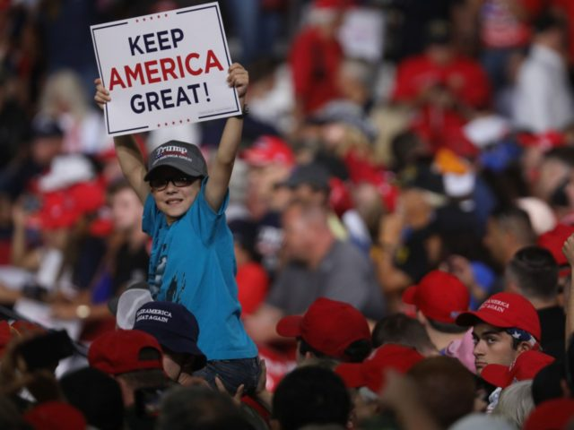 MANCHESTER, NEW HAMPSHIRE - AUGUST 15: People cheer as President Donald Trump prepares to speak to supporters at a rally in Manchester on August 15, 2019 in Manchester, New Hampshire. The Trump 2020 campaign is looking to flip the battleground state of New Hampshire with the use of a strong …