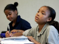 London McCoy, 10, right, and Jaclyn Williams, 10, do homework during their study hall session at View Park Prep Charter School Tuesday, Oct. 11, 2005, in South Los Angeles. Specialty schools that shun many of the methods of traditional public schools are no longer just the purview of privileged suburban …