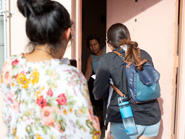 MIAMI, FL - JULY 13: Immigration advocates with the Florida Immigrant Coalition go house to house handing out fliers on July 13, 2019 in Little Havana in Miami, Florida. The Trump administration is moving forward with a nationwide immigration enforcement operation this weekend targeting migrant families. (Photo by Saul Martinez/Getty …