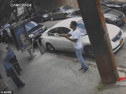 water-thrown-cops-queens-new-york